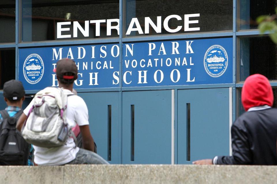 Students hung out near the entrance to Madison Park Technical Vocational High School in Roxbury.