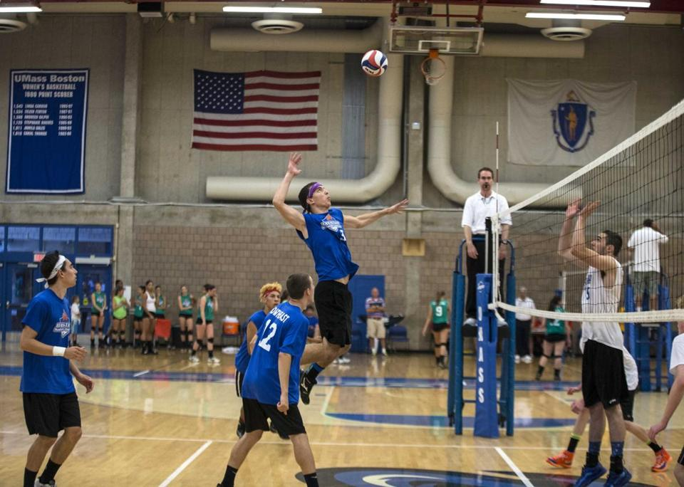 Matt Kuda elevates to spike the ball for his Northeast team. The Northeast squad won the gold medal Sunday.