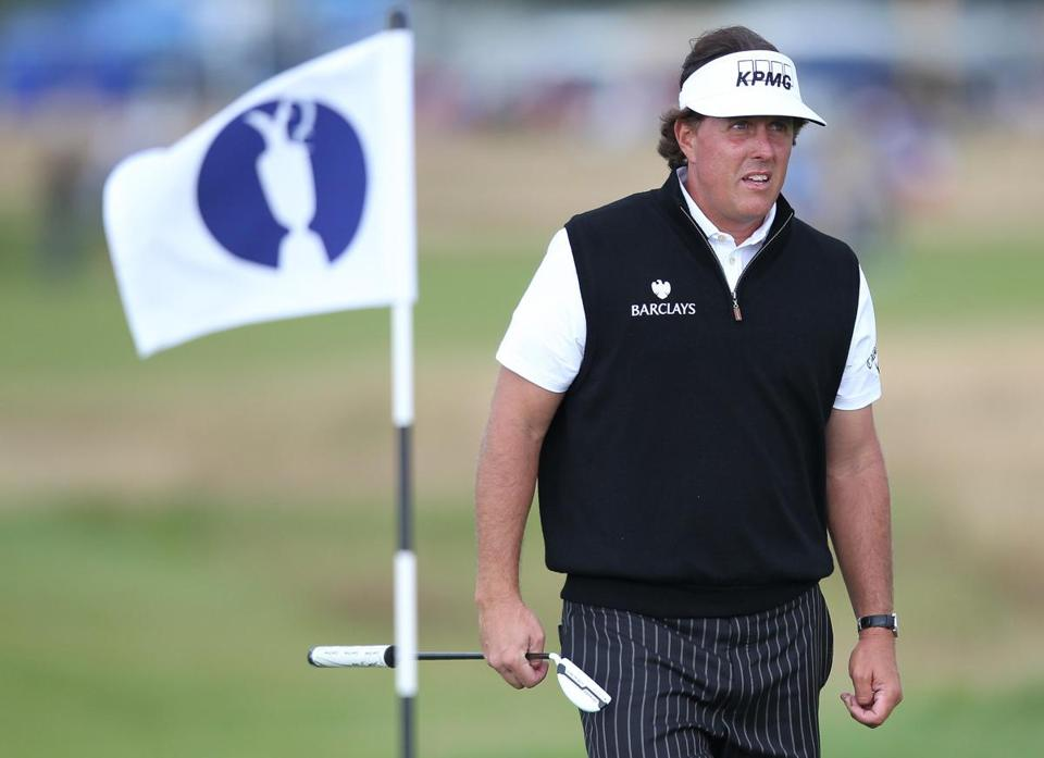 Phil Mickelson got in a practice round Monday in preparation for his title defense at the British Open. AFP PHOTO / PETER MUHLYPETER MUHLY/AFP/Getty Images