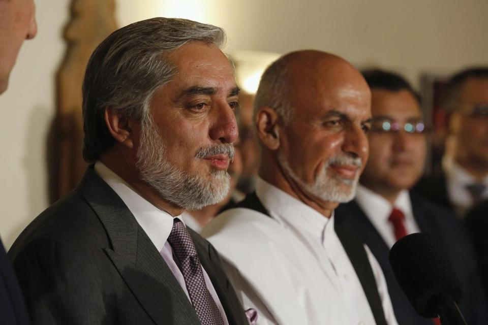 Afghan presidential candidate Abdullah Abdullah, left, and rival candidate Ashraf Ghani appeared in Kabul Saturday.
