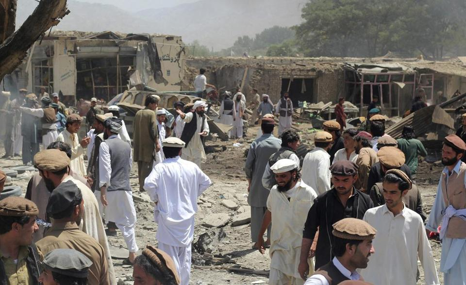 People gathered at the scene of a suicide bomb attack in Paktika, Afghanistan, on Tuesday.