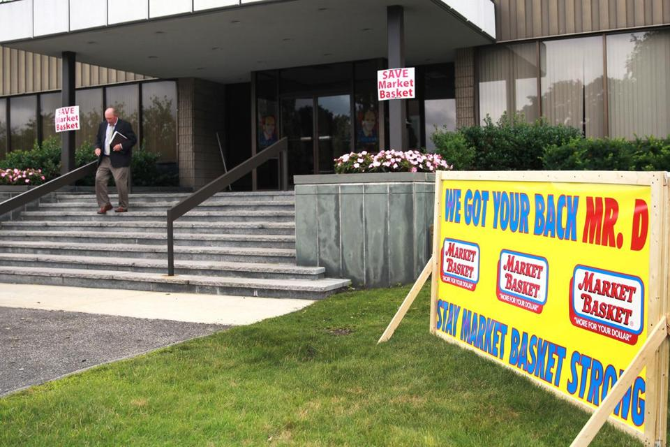 Employees have posted signs inside and outside company headquarters in support of ousted president Arthur T. Demoulas.