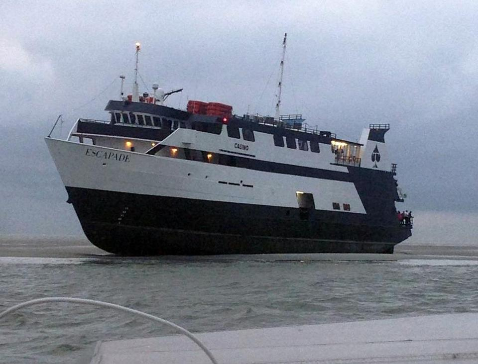 The casino boat Escapade, with 123 people aboard, was grounded off the coast of Tybee Island, Ga.