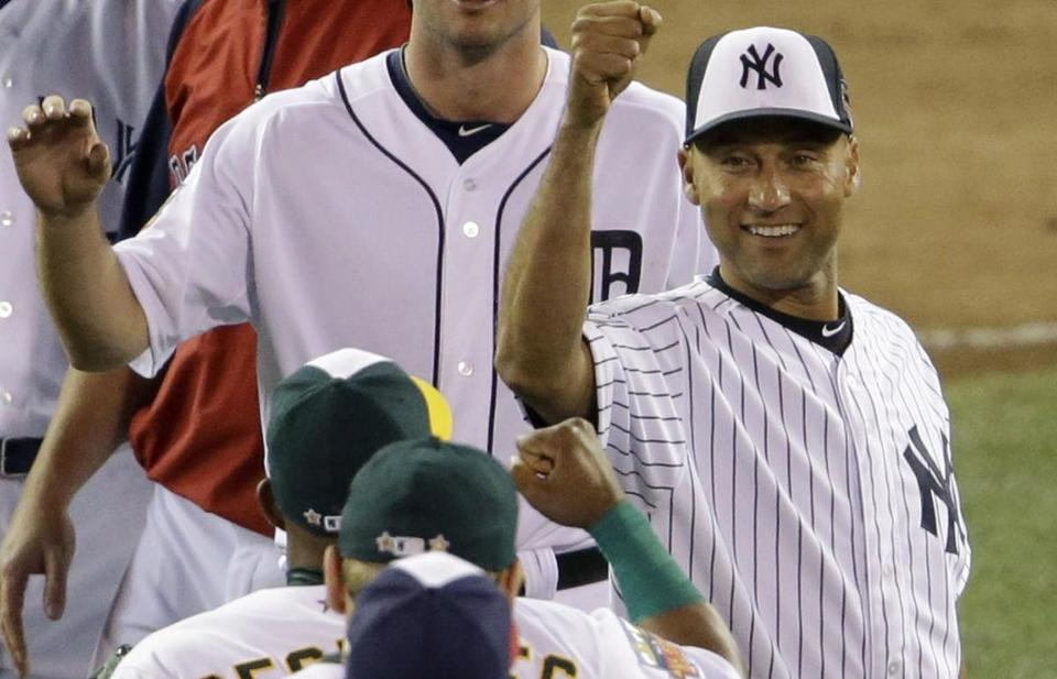 Derek Jeter celebrated with his AL teammates after beating the NL in the All-Star Game.