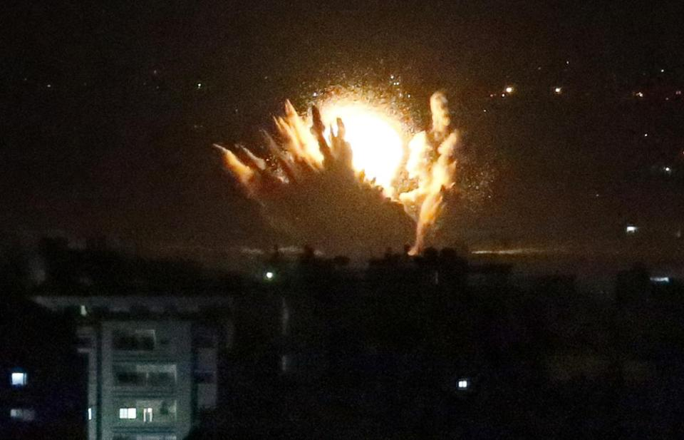 An Israeli missile hit buildings in Gaza City on Thursday. The military says it has launched a ground operation.