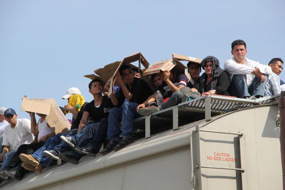 Central American immigrants sat atop the so-called La Bestia (The Beast) cargo train, in an attempt to reach the Mexico-US border.