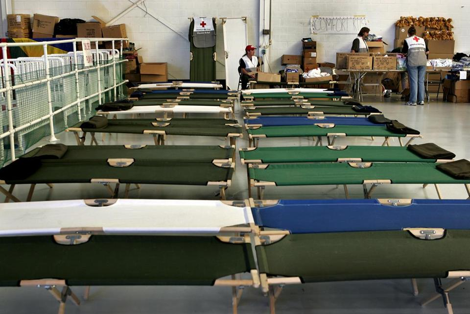 Cots and supplies were ready for Katrina evacuees at Camp Edwards.
