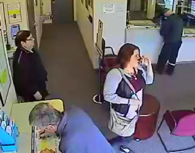 April 11: Surveillance video shows members of the Brudnick family cashing in winning tickets at the lottery's Woburn office.