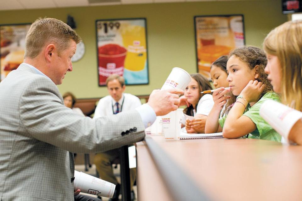 Scott Murphy, chief supply officer for Dunkin' Brands, responded to a question by Maya Rubin of the Park School's Styrofoam Club.