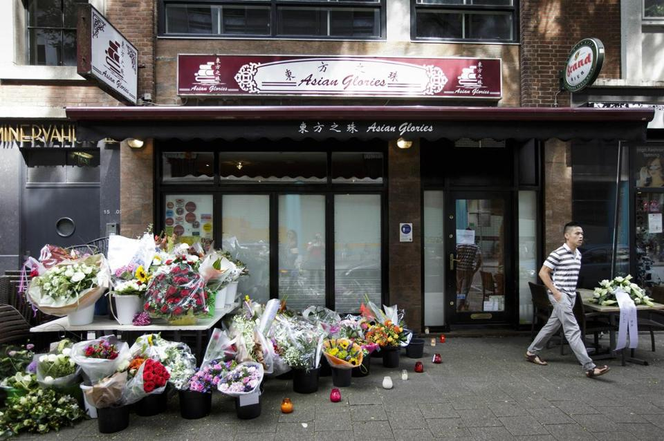 Flowers were outside a restaurant in Rotterdam. Both owners were killed in the crash.