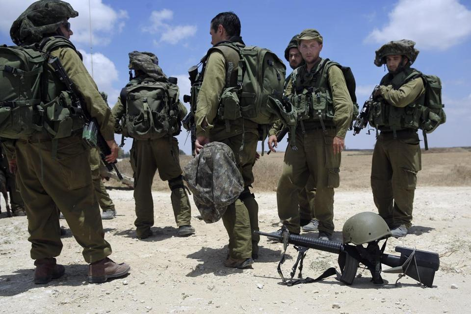 Israeli soldiers stood near the border with Gaza.