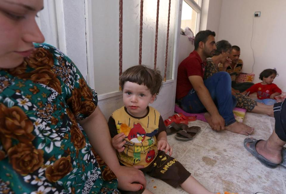 An Iraqi Christian family fleeing violence and persecution in Mosul arrived in the village of Qaraqush on Saturday.