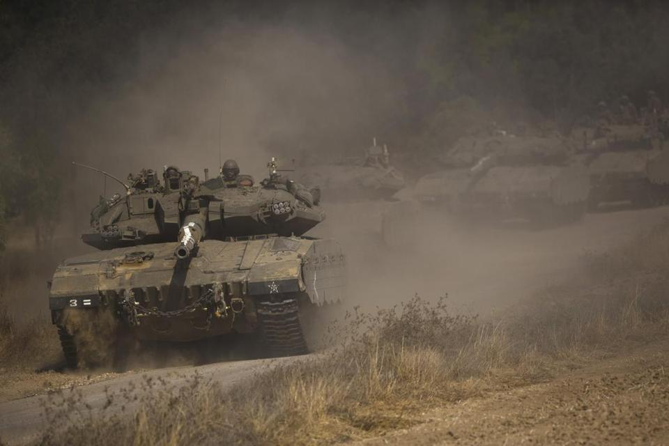 An Israeli convoy maneuvered outside the central Gaza Strip.