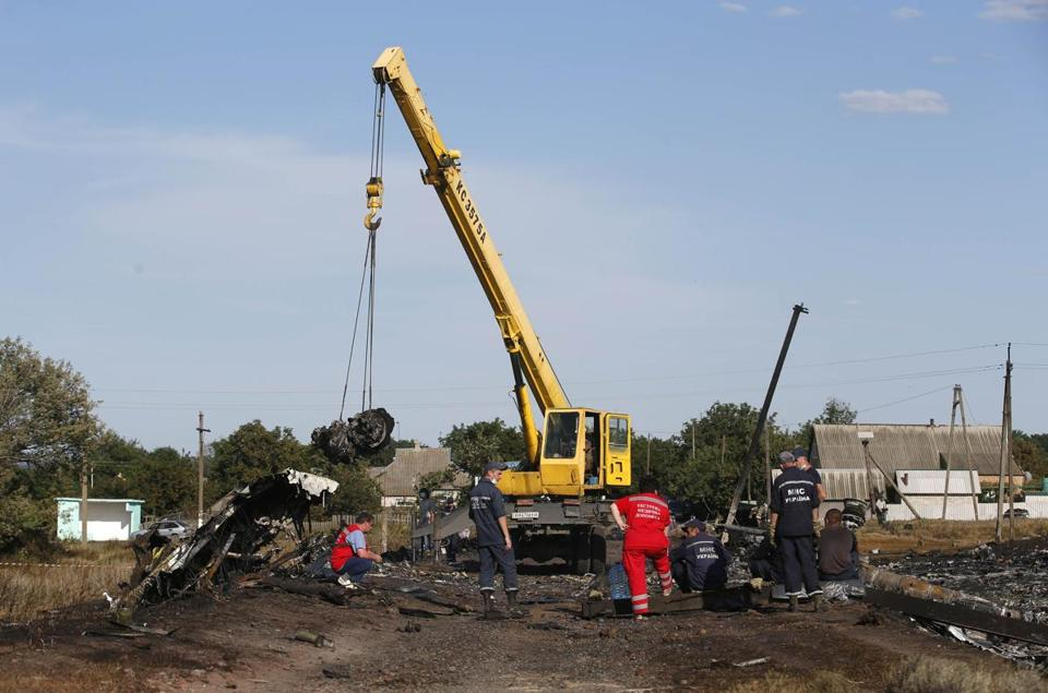 A crane worked at the crash site near the village of Hrabove in Ukraine.