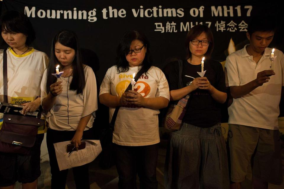Attendees at a vigil in Kuala Lumpur held a moment of silence.