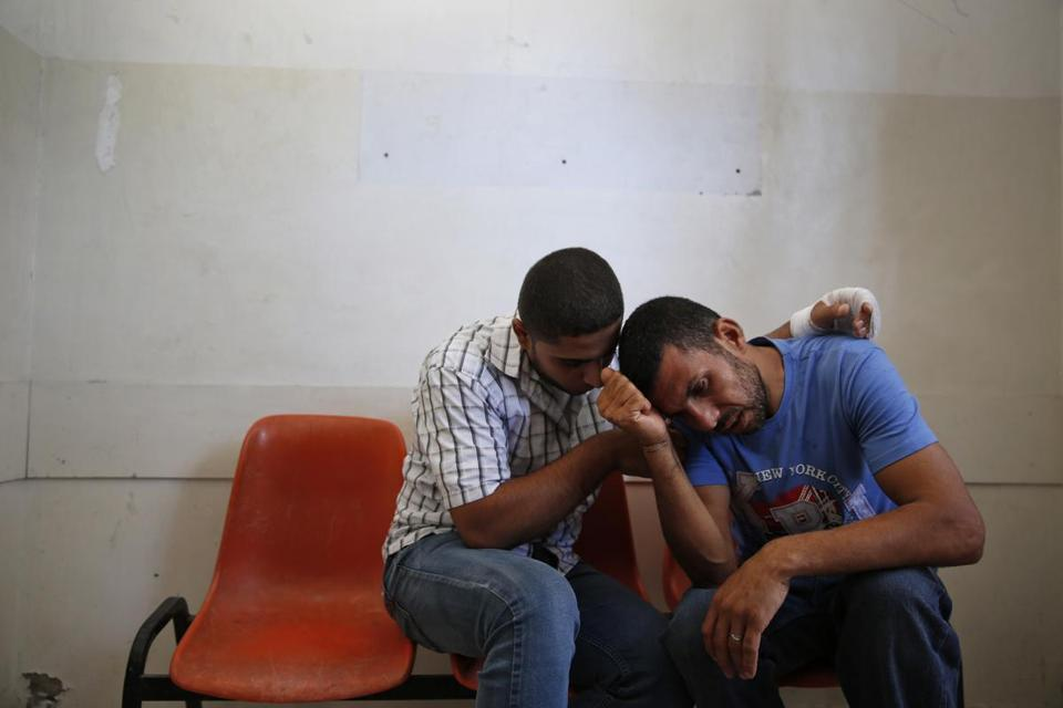 Relatives comforted each other as they mourned the loss of several family members killed by an Israeli airstrike.