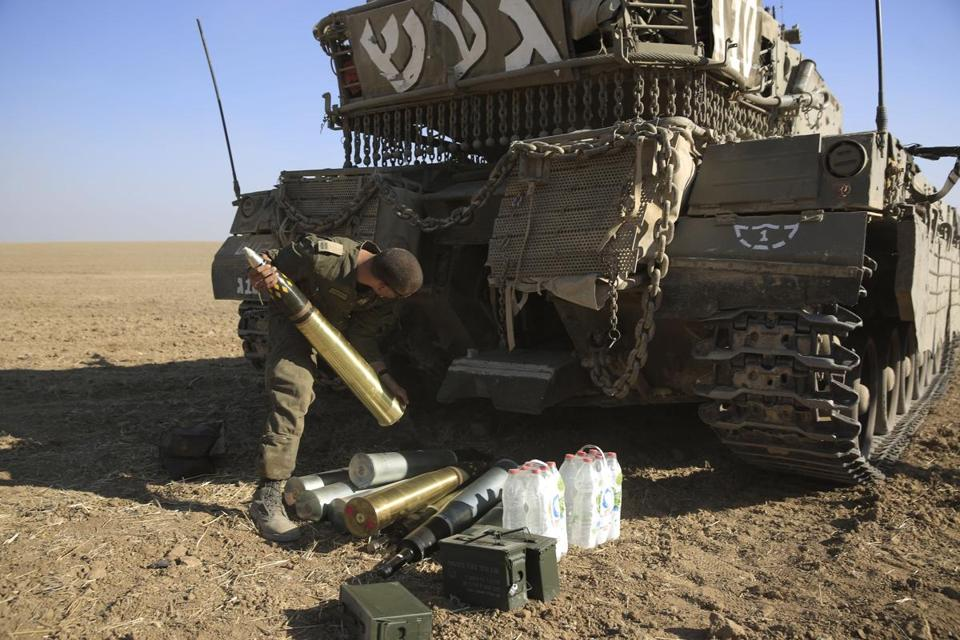 An Israeli soldier loaded tank shells near the border with Gaza.