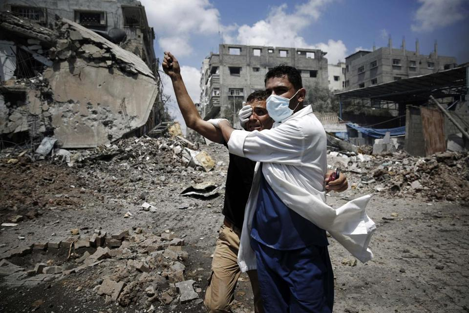 A medic helped a Palestinian in the Shejaiya neighborhood of Gaza City, which was heavily shelled by Israel Sunday.