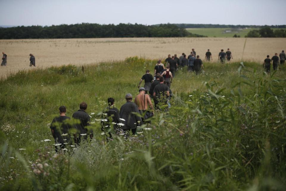 On Sunday, Ukrainian coal miners searched the site of Malaysia Airlines flight 17.