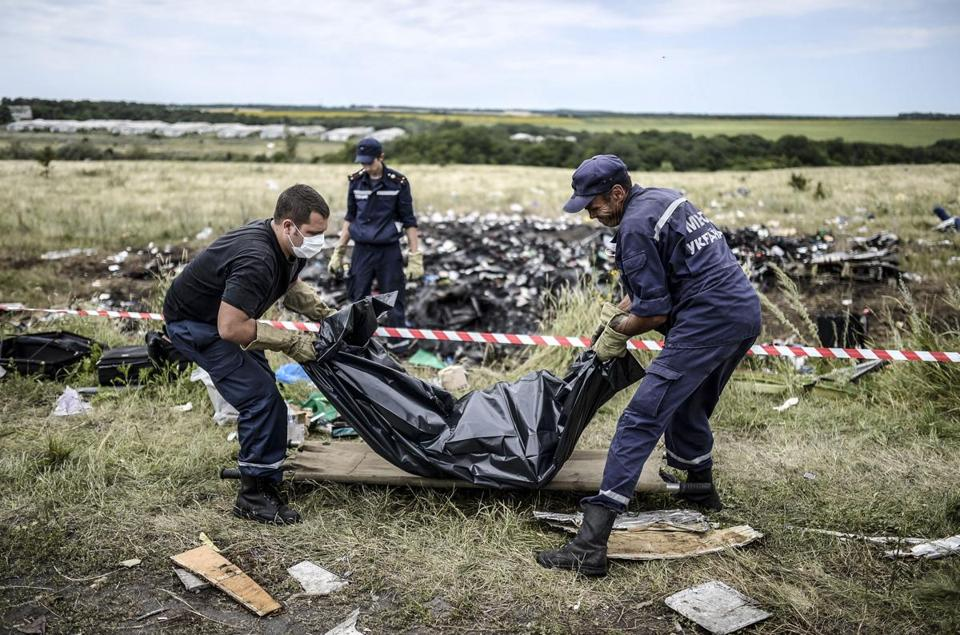 Ukrainian emergency employees collected bodies at the site of the crash on Sunday, but officials said they were forced to turn them over to rebels.