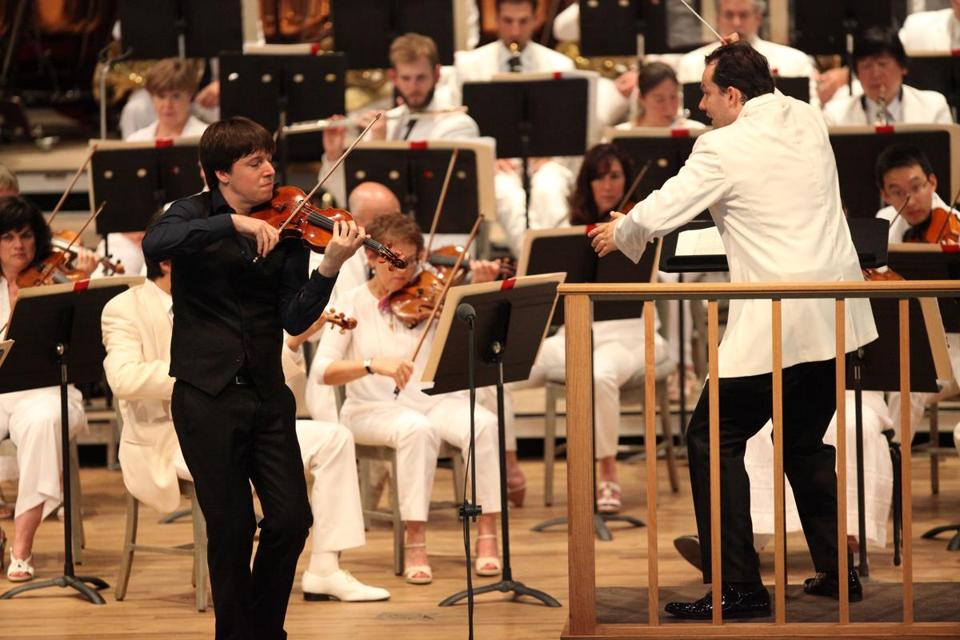 Andris Nelsons leading the Boston Symphony Orchestra with violin soloist Joshua Bell on Sunday at Tanglewood.
