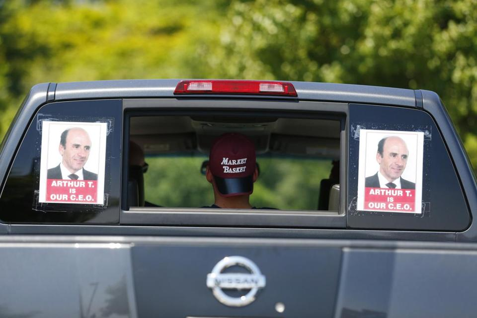 Supporters of Market Basket's fired president, Arthur T. Demoulas, at a rally in Tewksbury on Monday.
