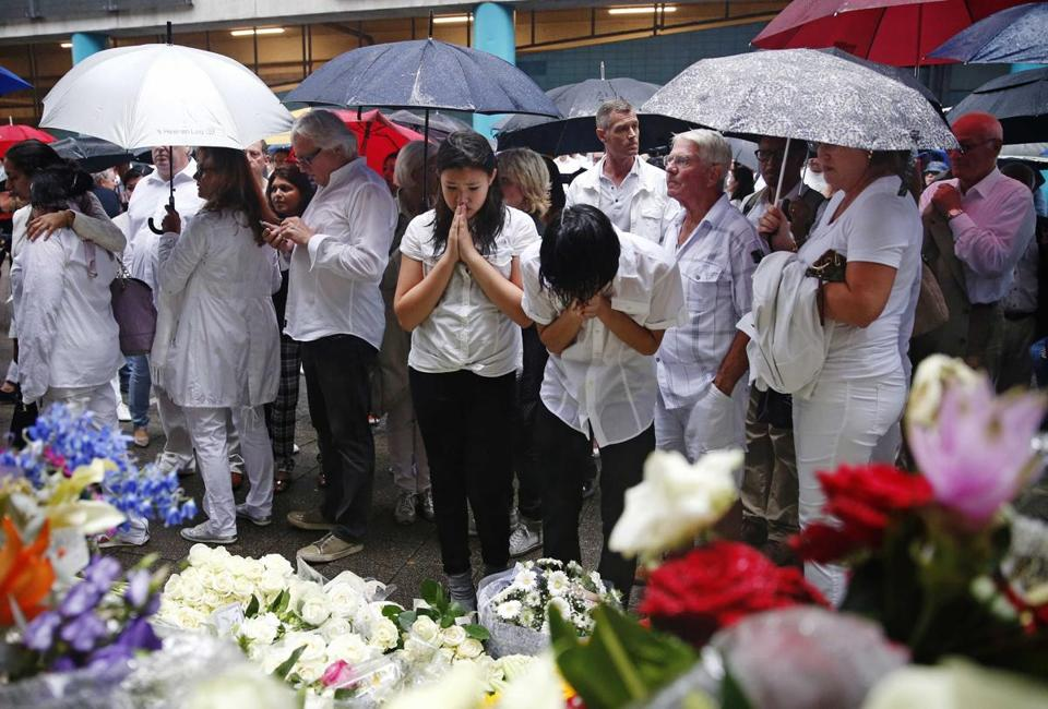 Mourners wore white at a remembrance gathering Monday in Rotterdam for Malaysia Airlines Flight 17 passengers.