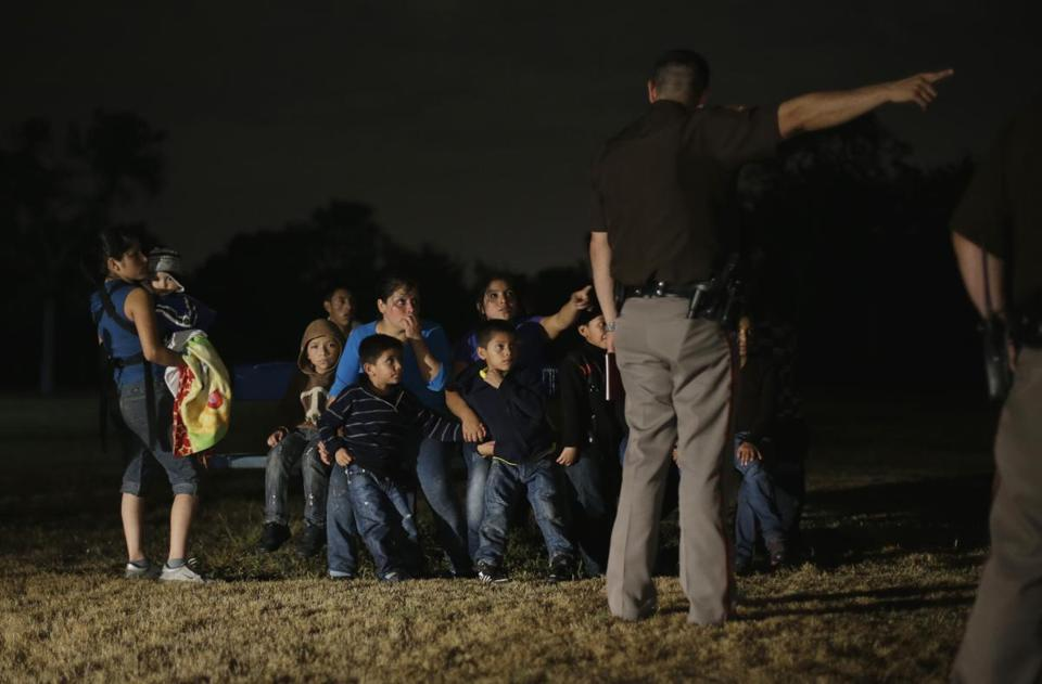 A group of immigrants from Honduras and El Salvador who crossed the U.S.-Mexico border illegally are stopped, Wednesday, June 25, 2014, in Granjeno, Texas. At least six local, state and federal law enforcement agencies patrol the five mile zone which is illegal immigration's busiest corridor. (AP Photo/Eric Gay)