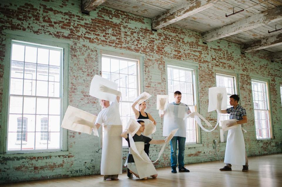 "From left: Bang on a Can musicians Mark Stewart, Jay Sager, Adrianne Pope, Chuck Furlong, and David Cossin rehearse artist Ann Hamilton's ""Paper Chorus."""