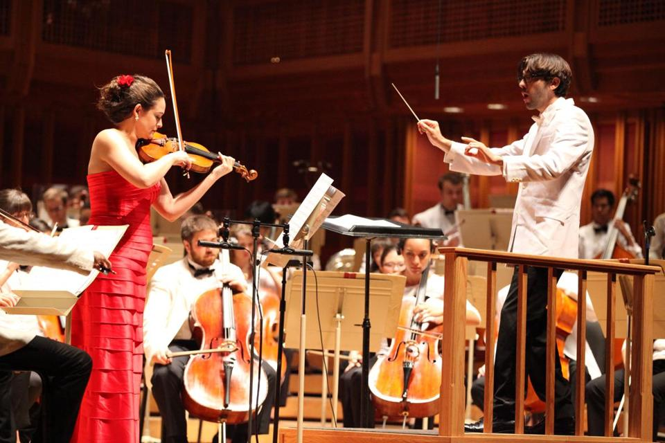 Daniel Cohen leading the Tanglewood Music Center Orchestra and violinist Sarah Silver on Monday at Tanglewood's Festival of Contemporary Music.