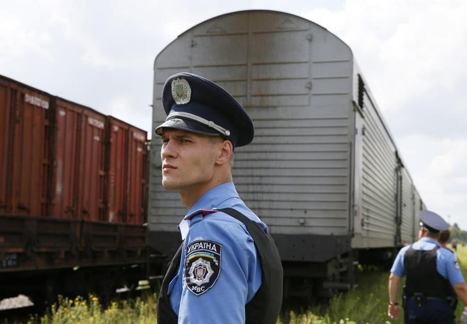 A Ukrainian policeman watched as a train carrying the remains of the victims of Malaysia Airlines MH 17.