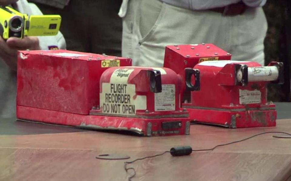 The two black boxes recovered from the crash site of the MH17 jet being were handed over to Malaysian officials during a press conference in Donetsk on Tuesday.