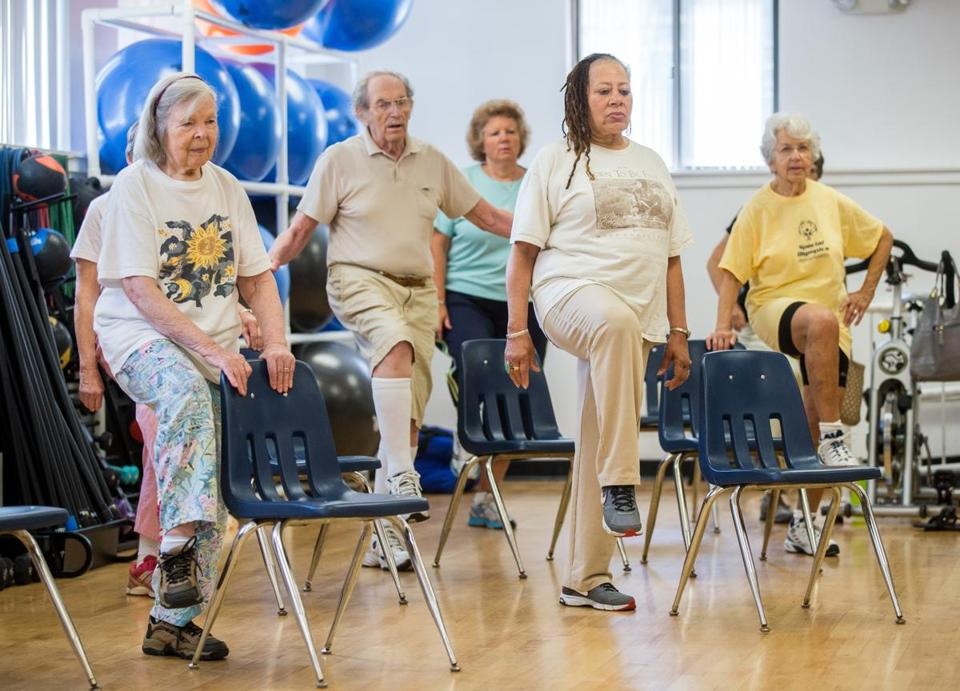 Seniors participate in a fitness class at Framingham's MetroWest YMCA, which is a part of a regional effort to boost preventive health care.