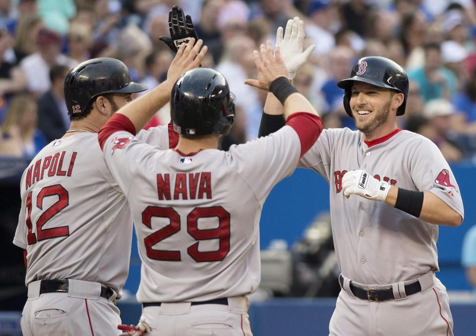 Stephen Drew, right, celebrated his three-run home run with teammates Mike Napoli, left, and Daniel Nava during the third inning.