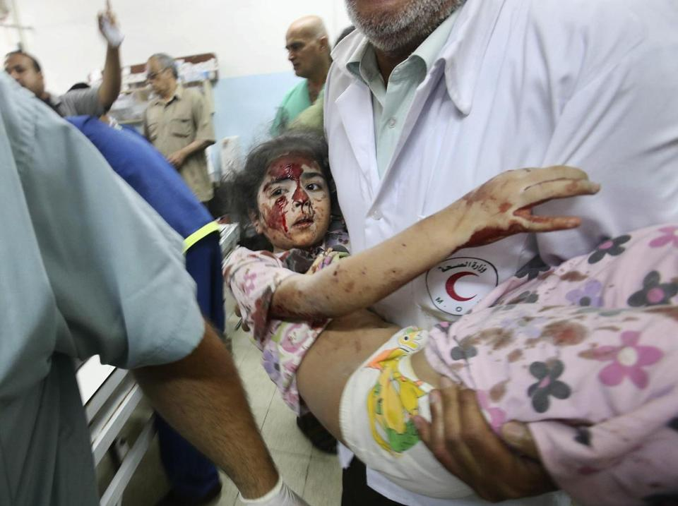 Palestinian medical personnel carried a girl, who they said was wounded by Israeli shelling, to a hospital in Khan Younis in the southern Gaza Strip on Wednesday.