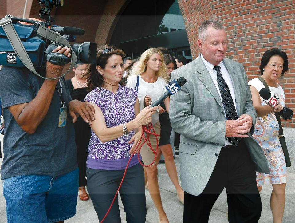 Former probation commissioner John O'Brien left federal court in Boston.