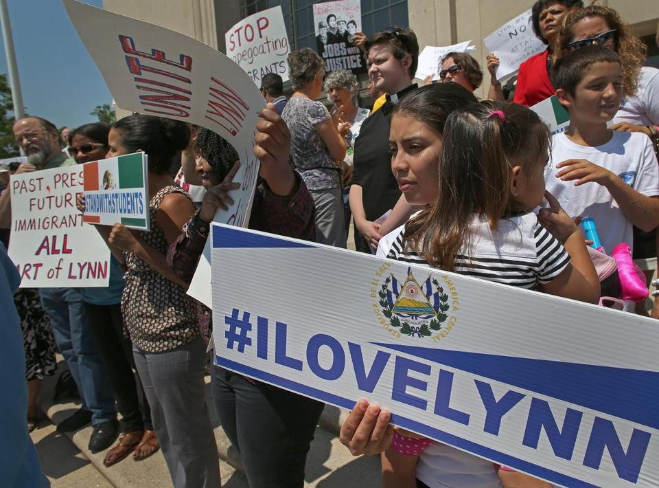 Kenia Tejada, who arrived from El Salvador in July, joined demonstrators at Lynn City Hall.