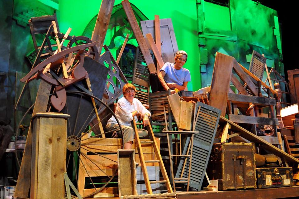 Artistic Director Zoe Bradford (left) and actor and designer, James A. Valentin (right), on the set of Les Miserables at The Company Theatre Centre for the Arts in Norwell.