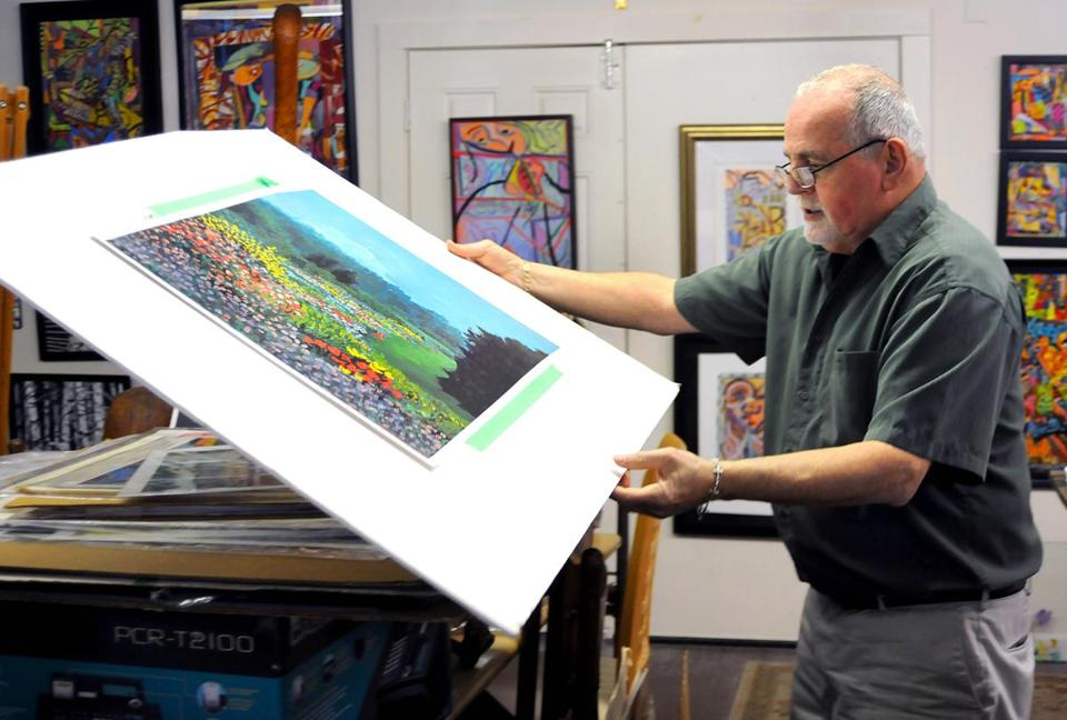 Paul Crimi goes through some of the hundreds of pieces in his Rockland studio.
