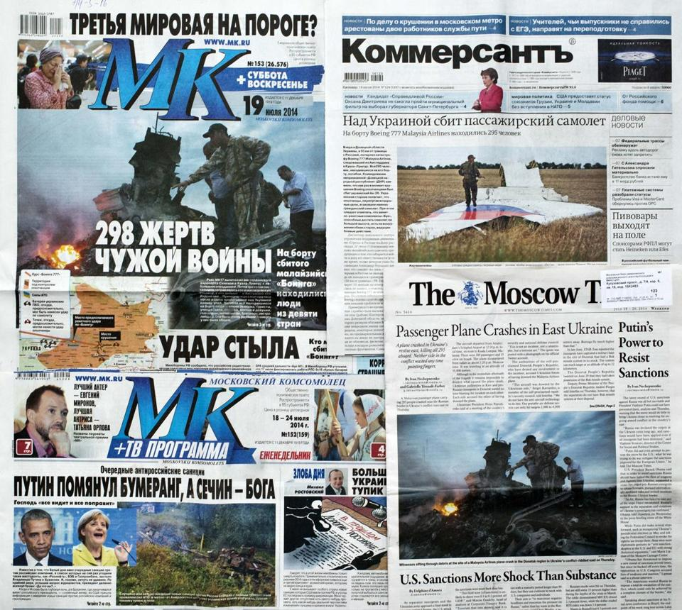 "Stories in Russian publications on the Flight 17 crash bear headlines about ""298 Victims of Someone Else's War,"" ""Kick From Behind,"" and an alleged assassination attempt against Putin."