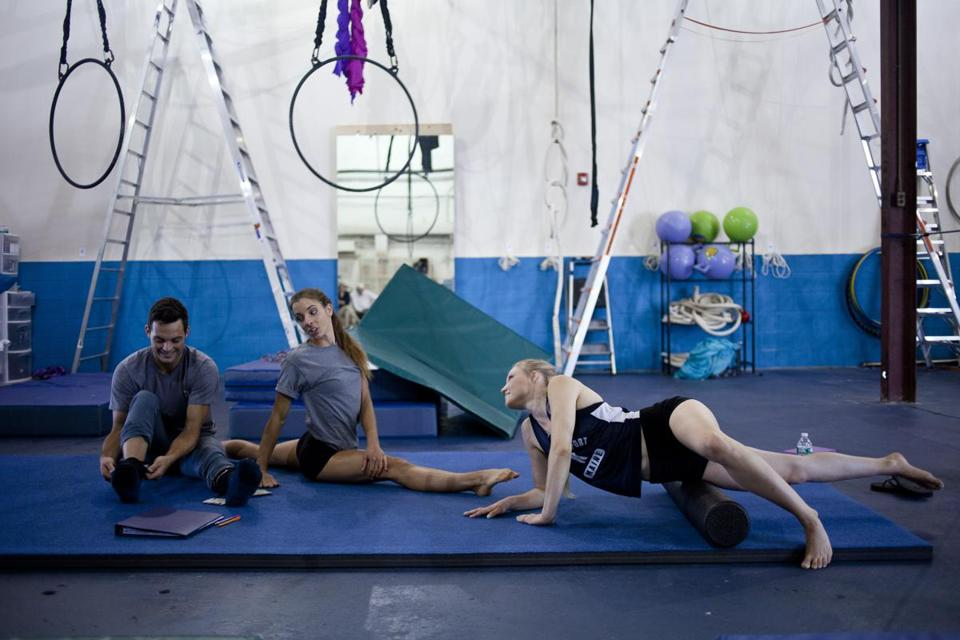From left: Patrick Tobin, of Milton, Lindsay Culbert-Olds, of Arlington, and Kia-Melinda Eastman, of Waltham, stretches and prepares for their practice at Esh Circus Arts in Somerville on July 25.