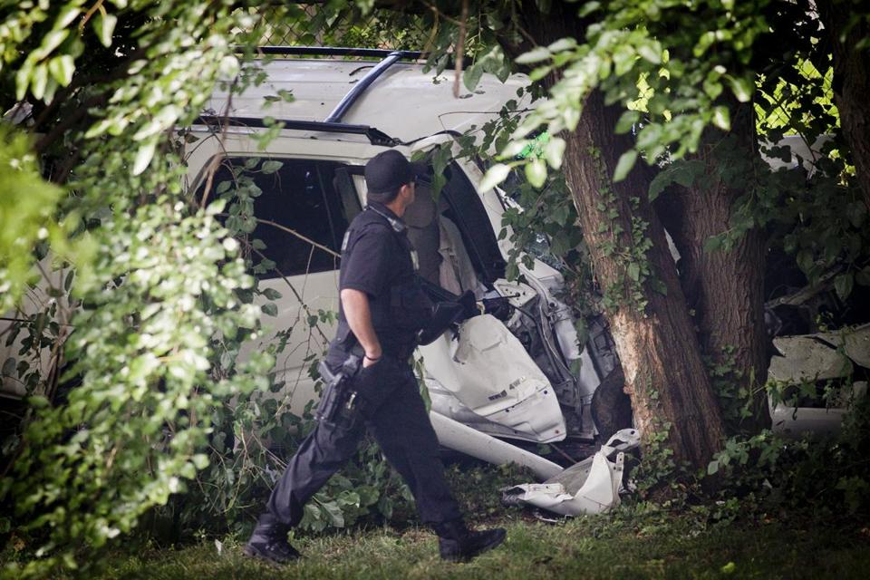 A police officer viewed the wreckage of an SUV that was carjacked before running into a crowd in Philadelphia.