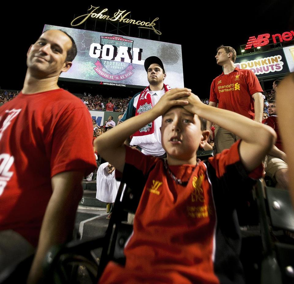 Ryan Leone, 9, of Millis, was in the Liverpool section of the Fenway Park bleachers.