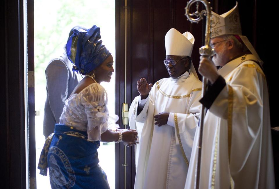 Chinyere Nwanekezi received a blessing from Cardinal Francis Arinze. Cardinal Sean P. O'Malley joined the celebration.