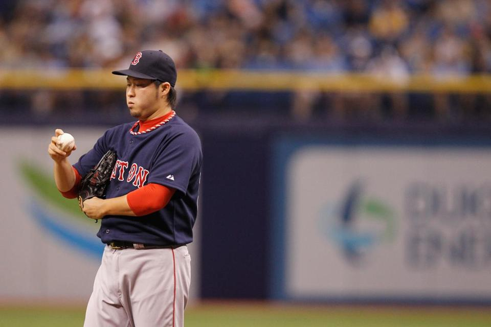 Junichi Tazawa failed to hold a one-run lead for Jon Lester, allowing the Rays to score four runs in the seventh inning. (Scott Iskowitz/Getty Images)