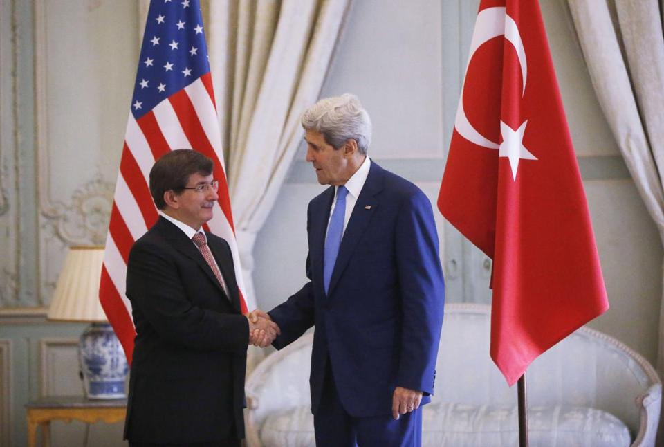 Kerry shook hands with Turkey's foreign minister, Ahmet Davutoglu, as dignitaries from around the world met in Paris Saturday to discuss the Gaza conflict.