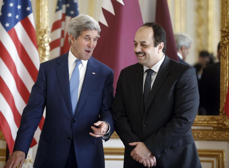 Qatari Foreign Minister Khaled al-Attiyah (right) and Kerry spoke before a press conference in Paris on Saturday.
