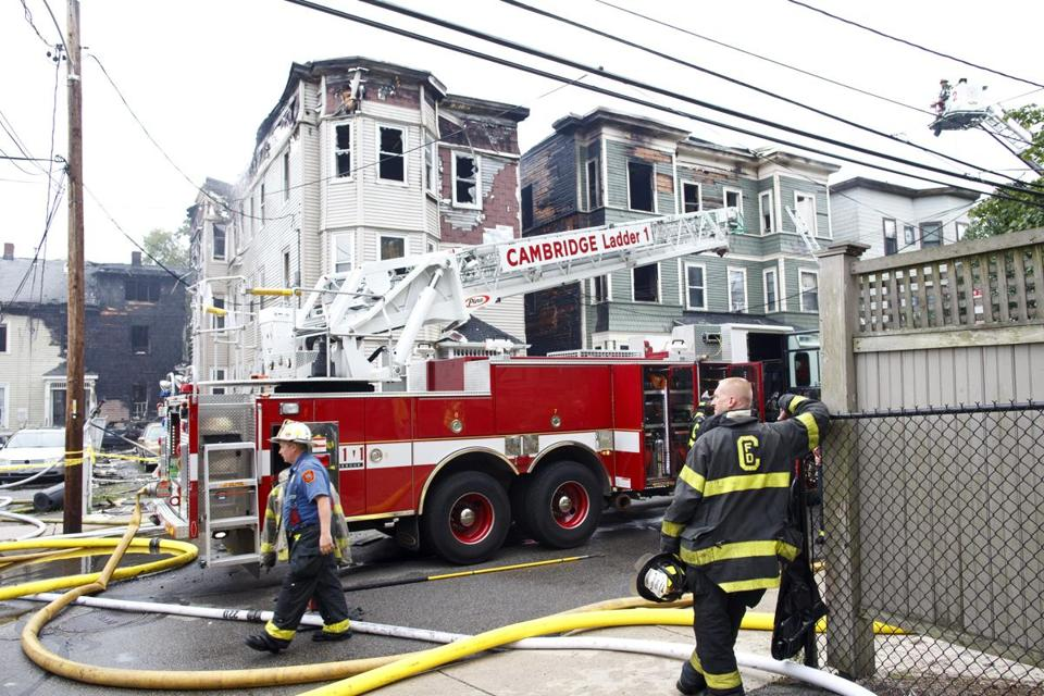 A nine-alarm fire in the densely populated Cambridgeport neighborhood spread to three apartment buildings early on Sunday morning.