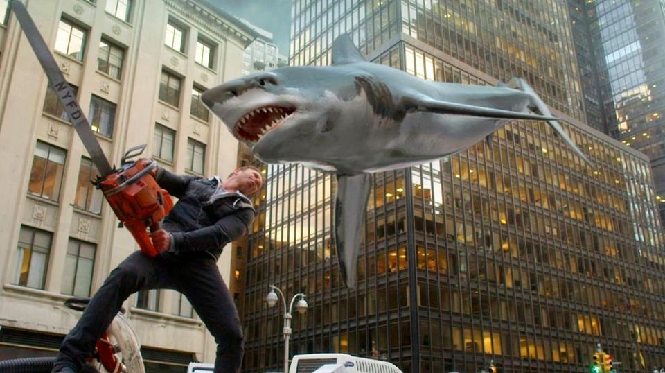 "Ian Ziering, as Fin Shepard, battles a shark on a New York City street in a scene from ""Sharknado 2: The Second One,"" premiering Wednesday at 9 p.m."