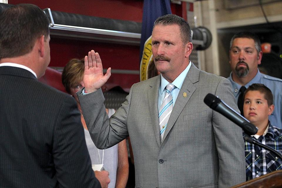 Joseph Finn was sworn into his new position by Boston Mayor Martin Walsh.